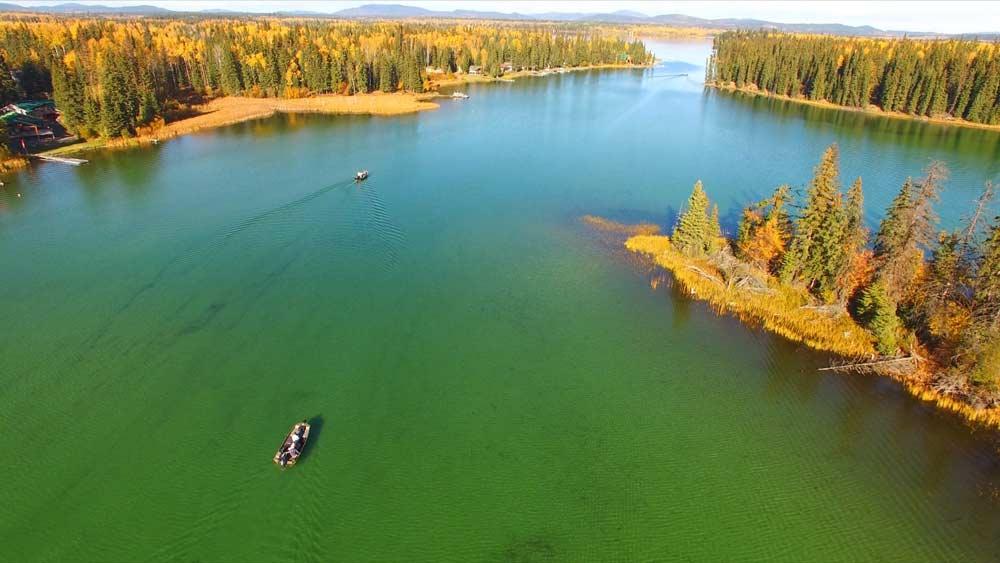 Don and Brian cruising on Sheridan Lake, scouting for fish.