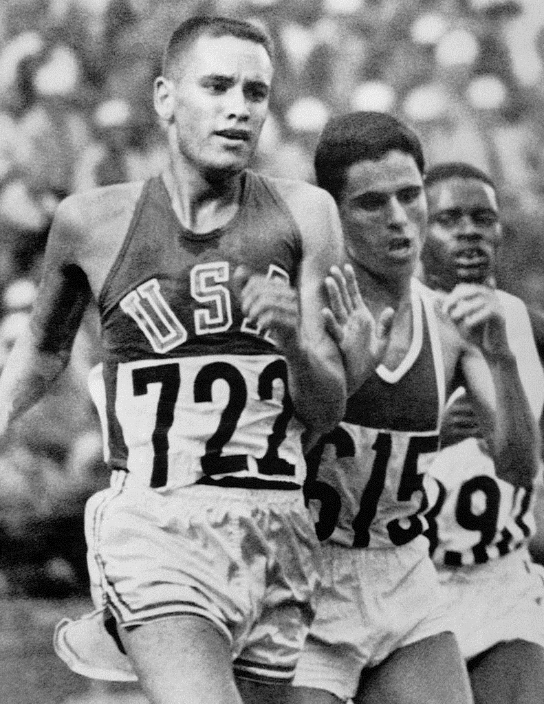 Billy Mills (left) competes with friend and fellow runner Mohammed Gammoudi of Tunisia (right) in the 1964 10K race. Gammoudi took home the silver medal. Photo by the  Associated Press