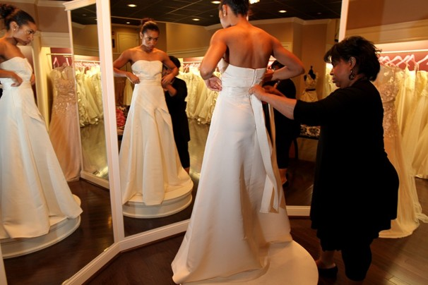 Miriam Liggett, owner of Soliloquy Bridal Couture, assists a bridal client.