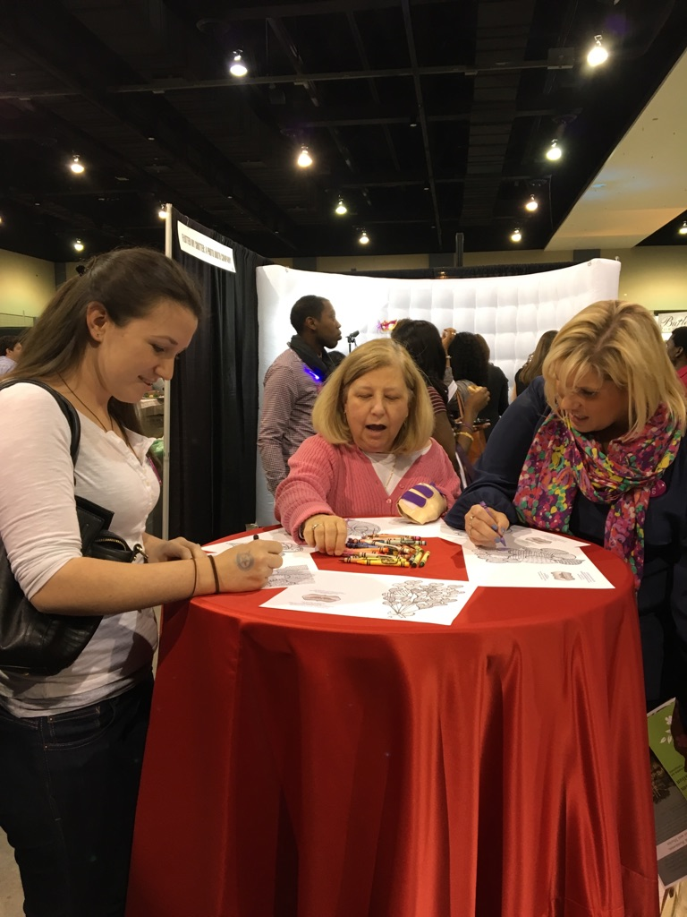 Richmond Wedding Experience attendees enjoying the Storybook Events Coloring Book.