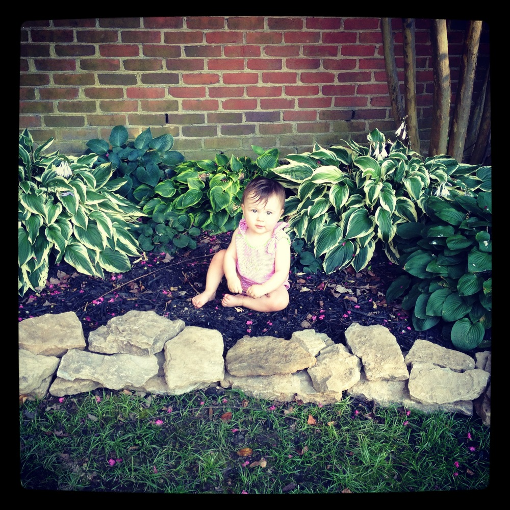 Helping trim Mimi's flower beds for her birthday.