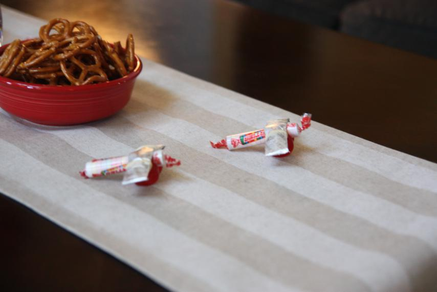 I made tiny airplane decorations out of Lifesavers, Smarties, and sticks of gum (an idea we found via Pinterest).