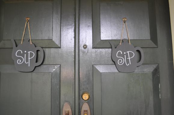 Tea kettle shaped signs on the front door.