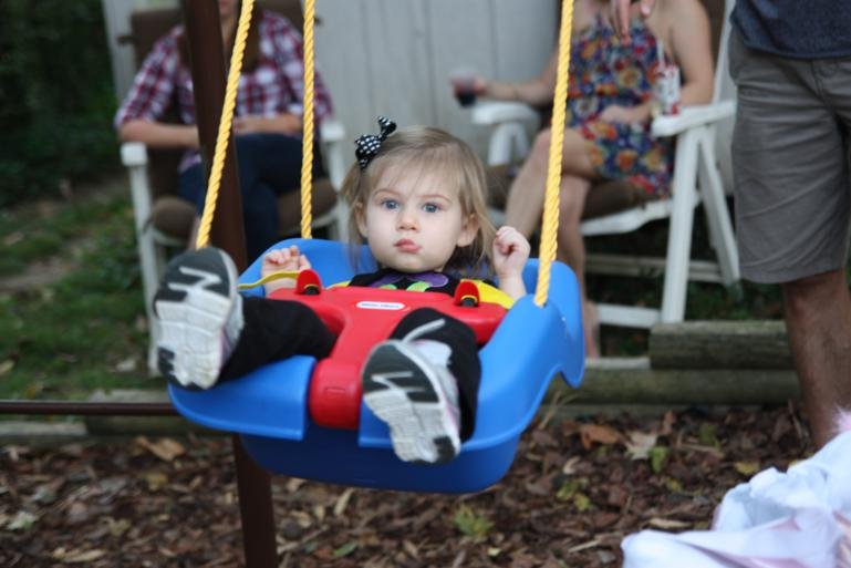 Olivia likes to swing as much as KW does!