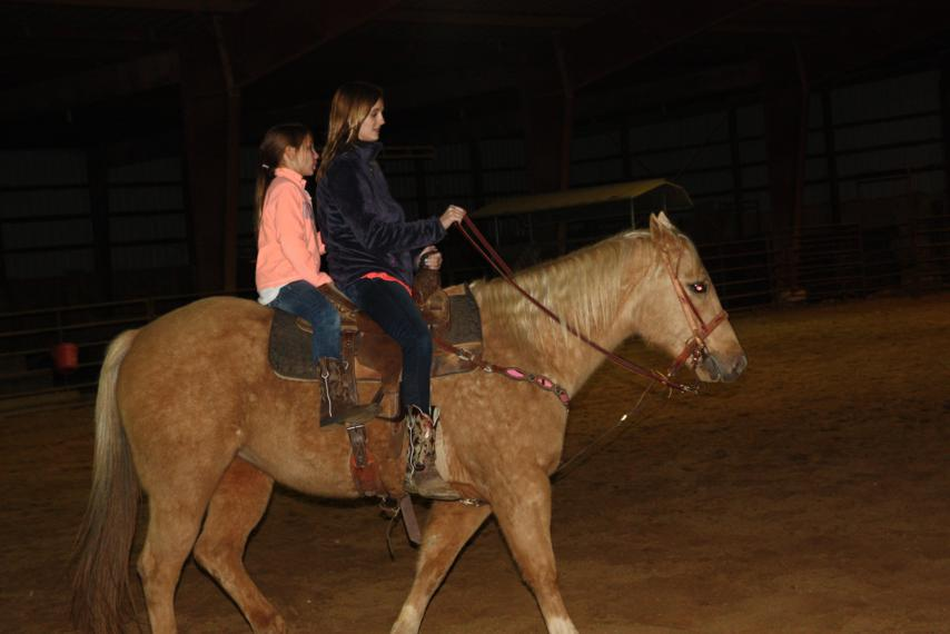 These girls - Roany and Gracie - are like pros compared to us.  Roany isn't even on the saddle!