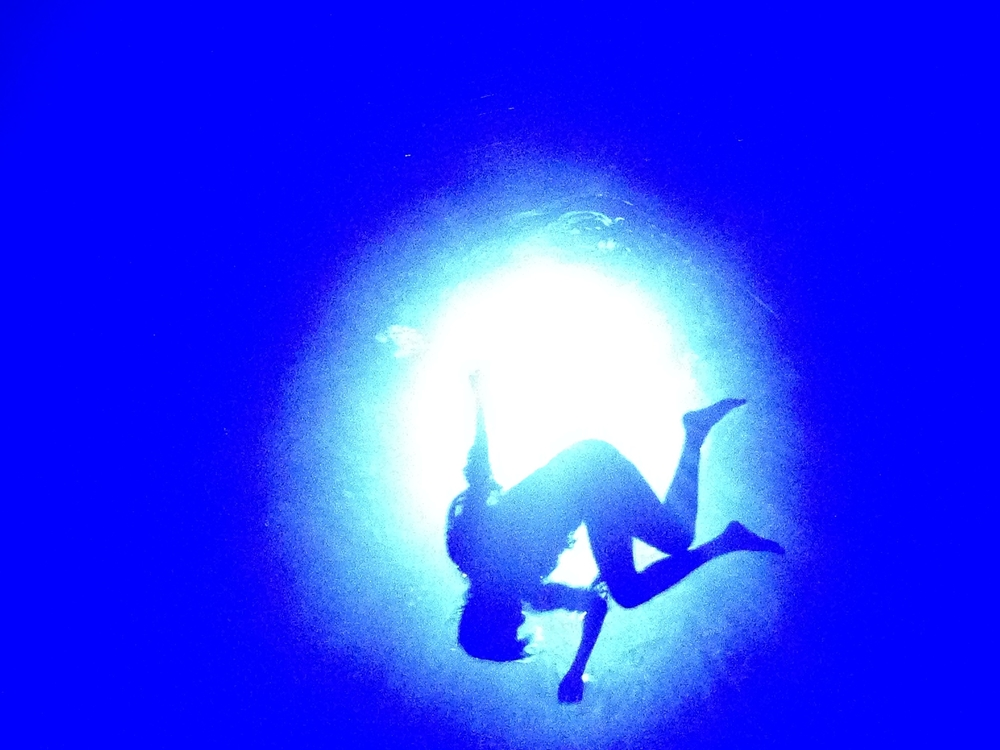 iphone capture of the amazing show Fuerza Bruta. Photo is looking up as a water filled ceiling approaches. I was WISHING my Nikon was in hand. :) This show is out of this world.