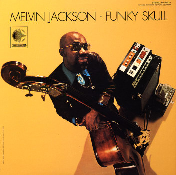 Melvin Jackson – Funky Skull Picture 8000 televisions facing inward as an igloo and you're inside of it and they're all playing Sanford and Son.  Whoa what the heck how did I get in here and why is half of Art Ensemble of Chicago here?  Melvin runs his bass through about twenty pedals and the result is the sound of a really cool duck being stepped on but the ducks on acid.  No joke this is absolutely superb soul-jazz that gets out and then comes back hard, gets out again, then makes you dance.  You can smoke weed and have a freaky little brunch to it with your mom.