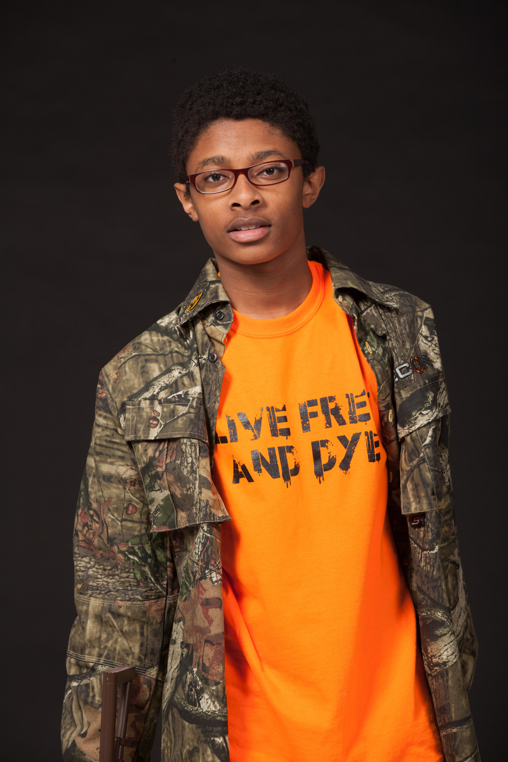 Model wearing camp while hunting