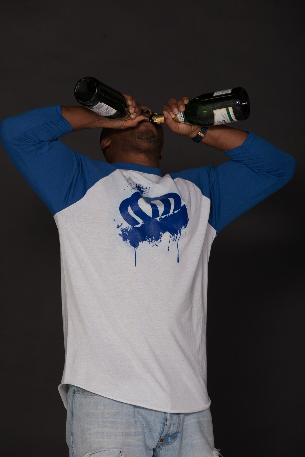 Charlotte crown graffiti shirt looks good on model pippin bottles.