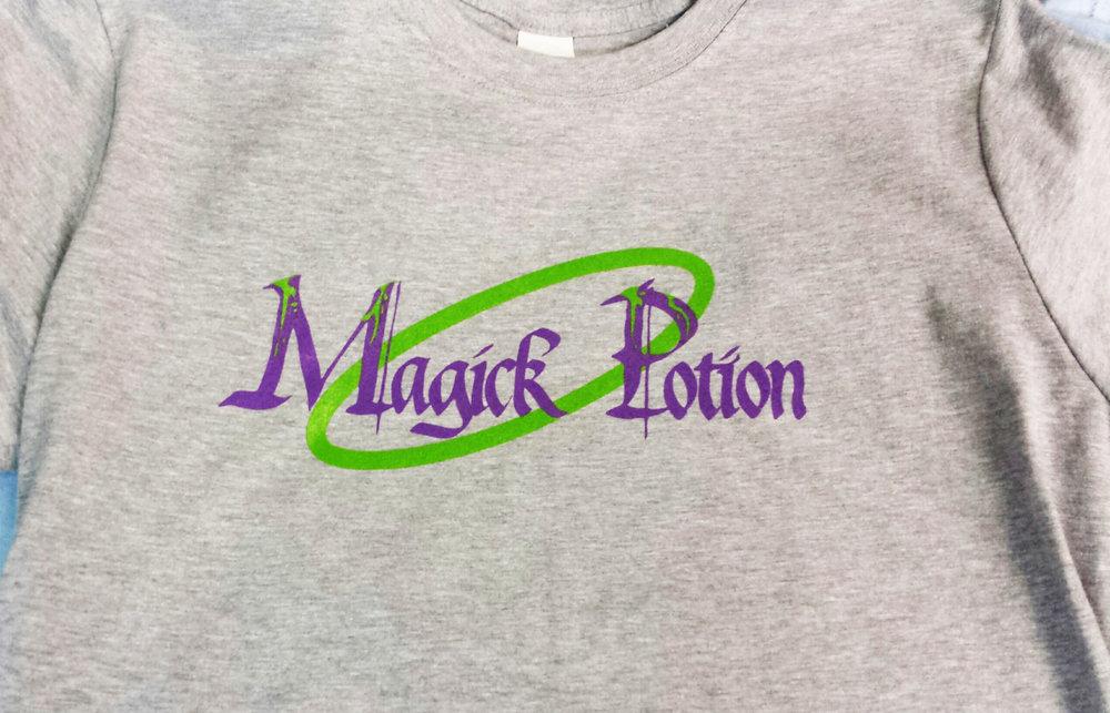 magic potion t shirt purple green on grey.jpg