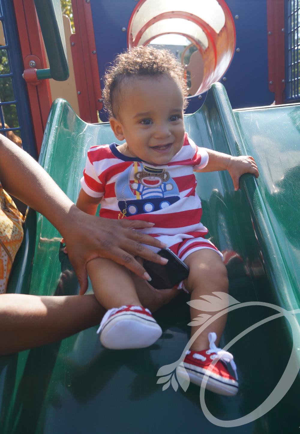 Josiah on slide.jpg