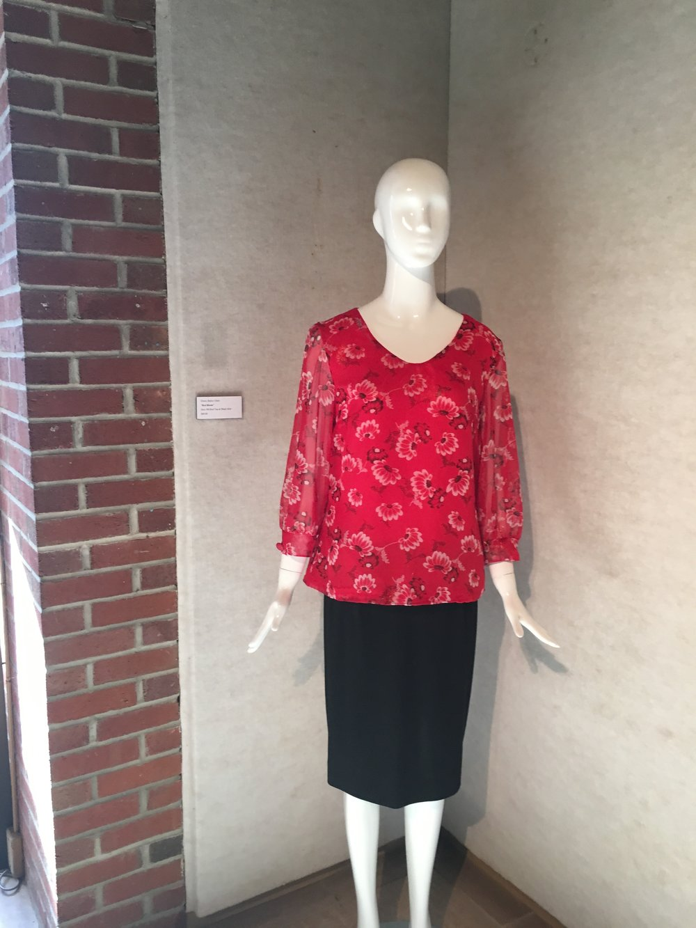 Fashion by: Ebony (Bailey) Glass right at the entrance of the gallery.