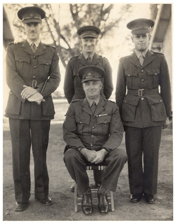 L-R Capt Morgan, Maj Lloyd, Lt Wastell Sitting: LtCol Robertson MC VD Commanding Officer
