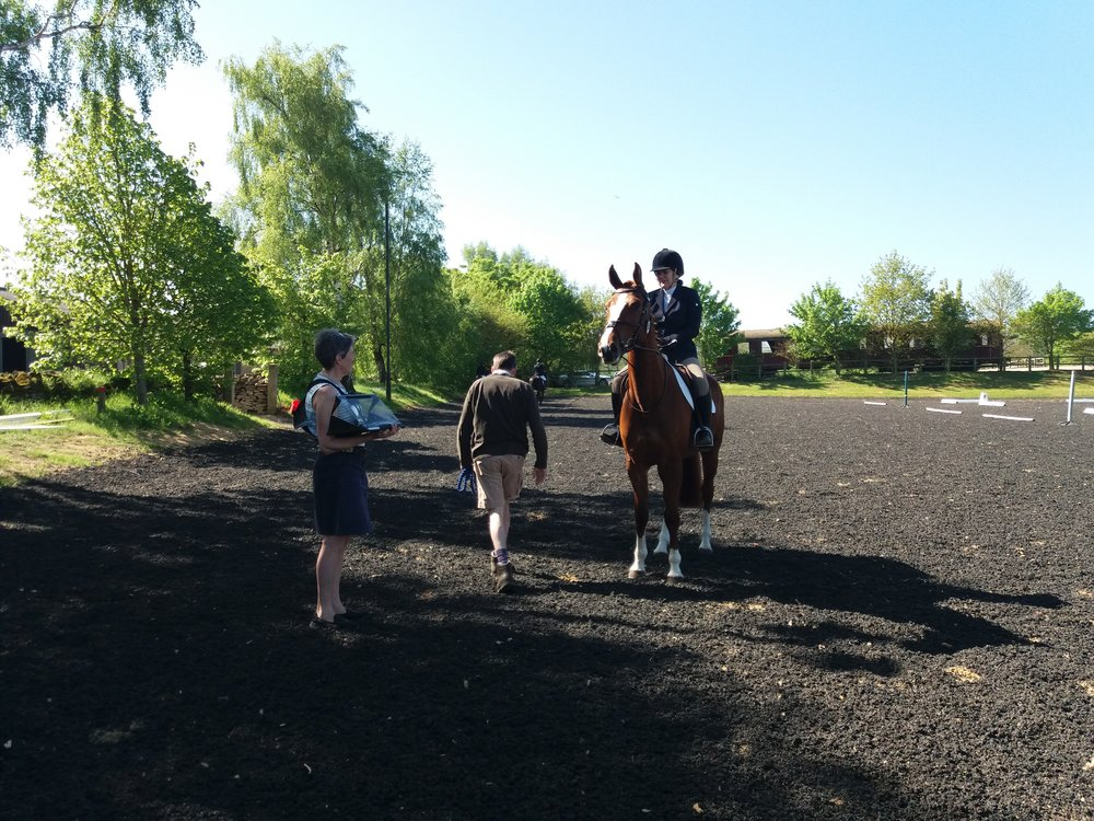 Nicky Thomson stewarding and chatting with Dawn Ross riding Ultratop Van Overis Z at the May Dressage Competition.