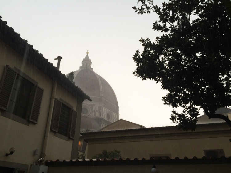 Sitting in my courtyard with the Duomo in the rain