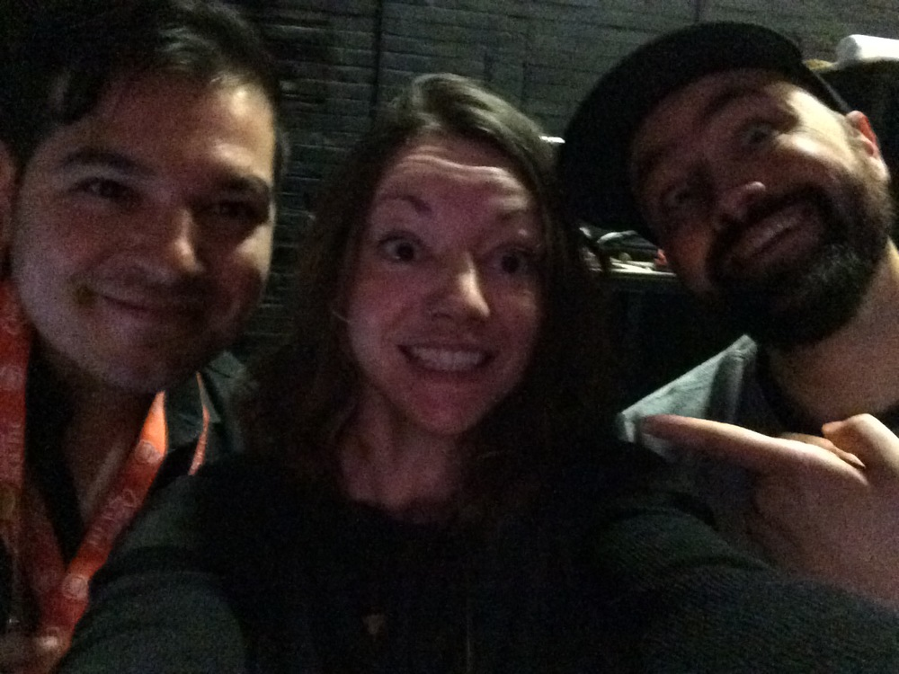 Poorly lit selfie of Meg, Justin and I. Closely knit like a sweater. I look rather psycho.