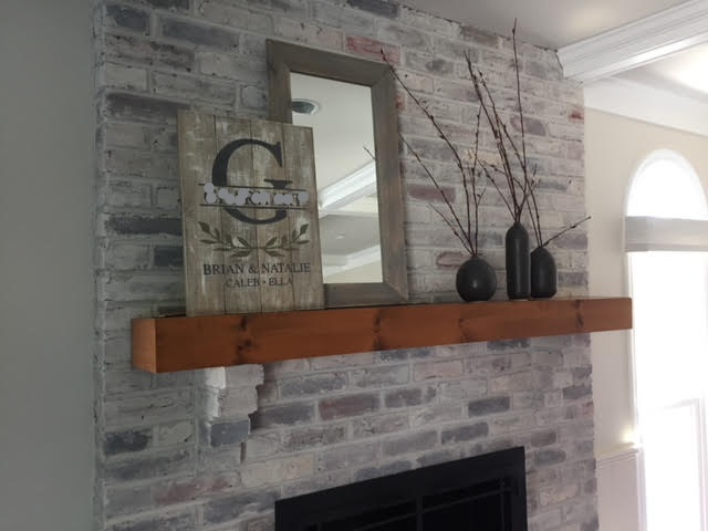 A formerly dark fireplace surround got a lightening-up, with a wash of equal parts gray paint and water, Bucks County, PA.