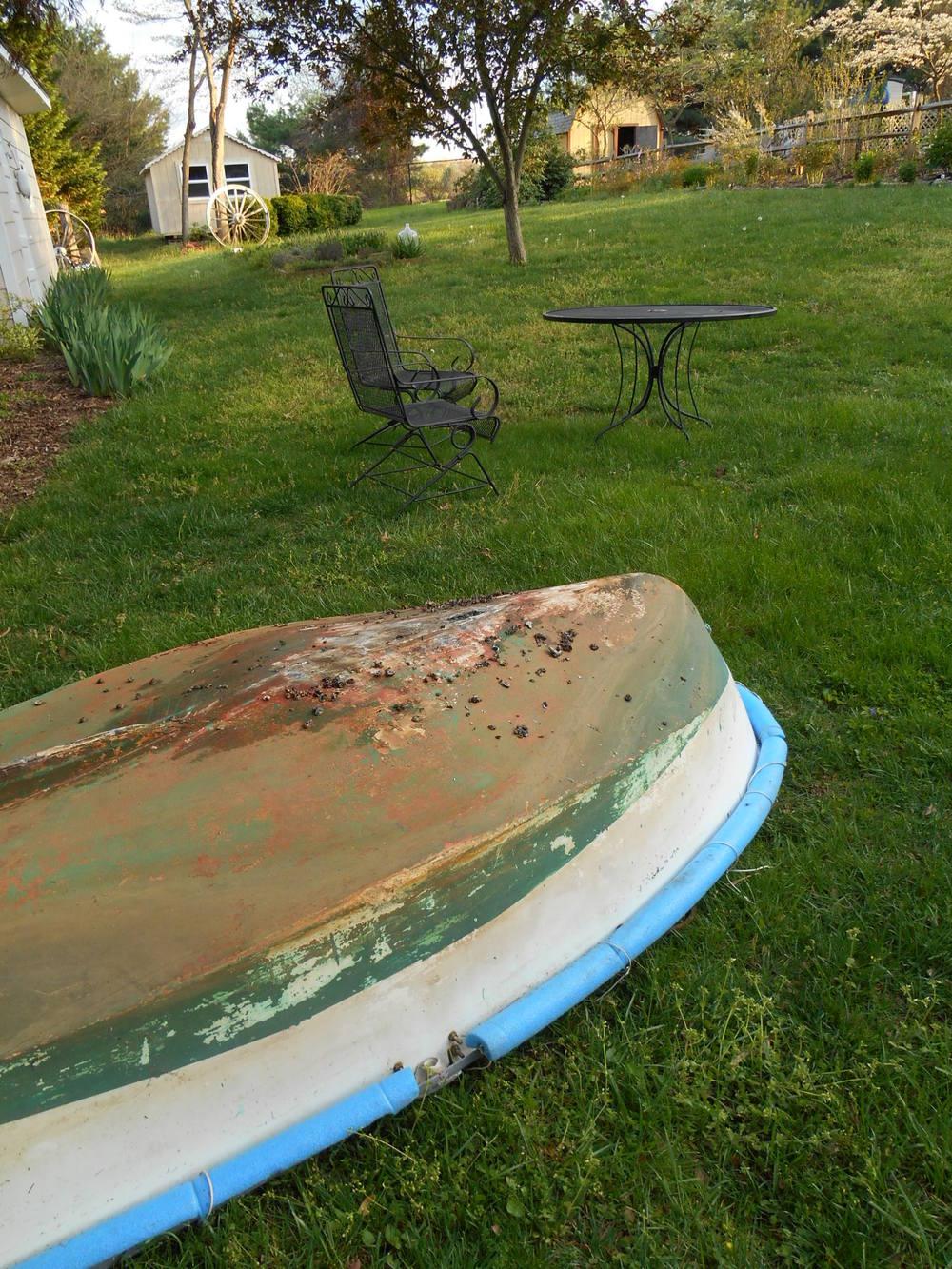 Lark's dinghy ... battered after a hard winter ...