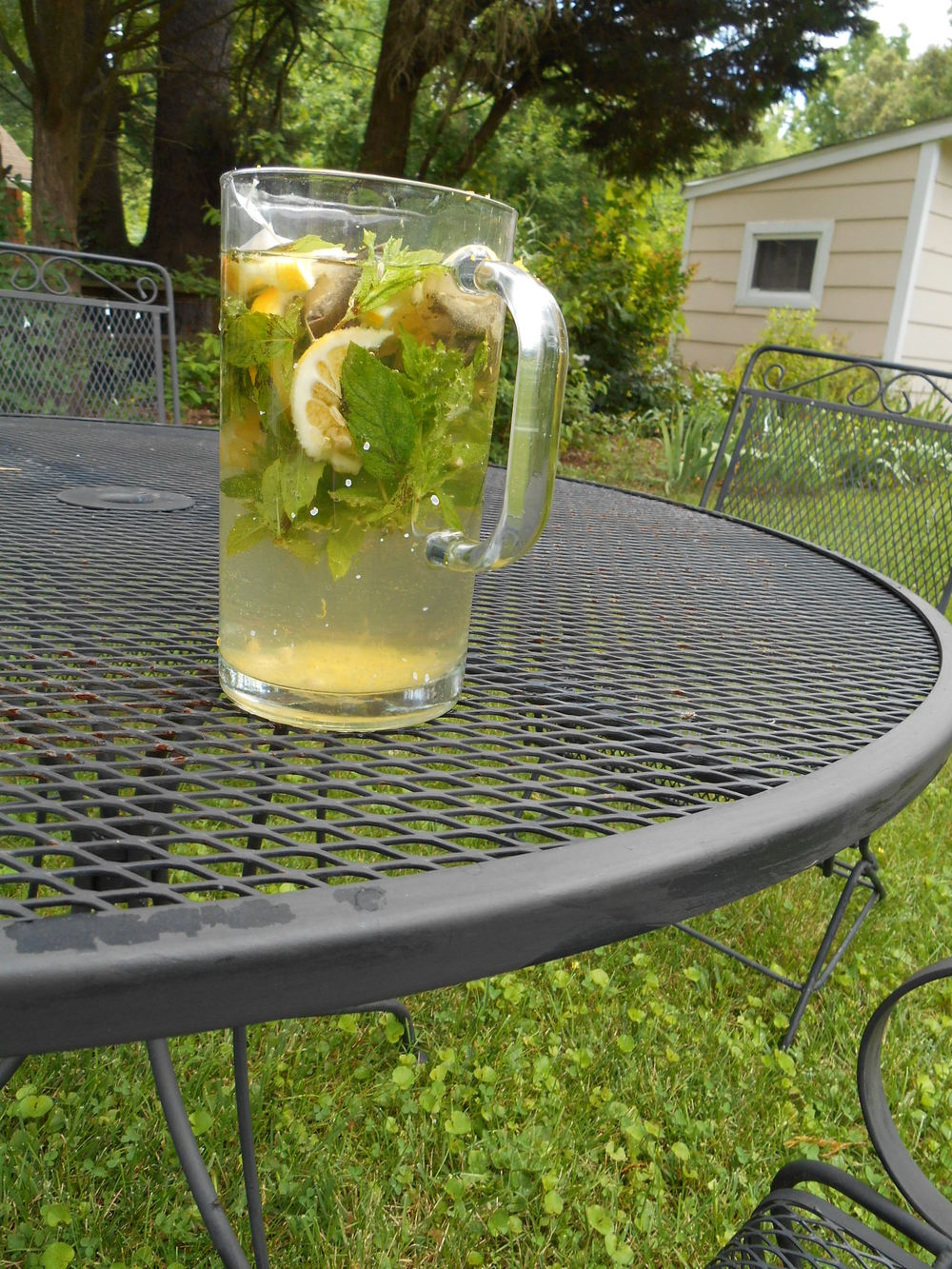 What a difference cool air in July makes here in Maryland!  Rowing out to Lark, for a while on board in the early morning, then weeding the asparagus bed, then concocting some sun tea ... green tea with jasmine, handful of mint and juice, grated rind, and sliced up Meyer lemon brought back from the garden of a friend in California .... aaaah .... grateful!