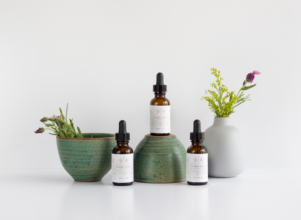 young-blood-boutique-wooden-spoon-herbs-tinctures.jpg