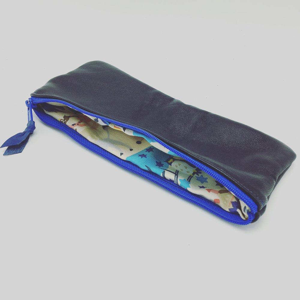 Blue lamb skin pouch