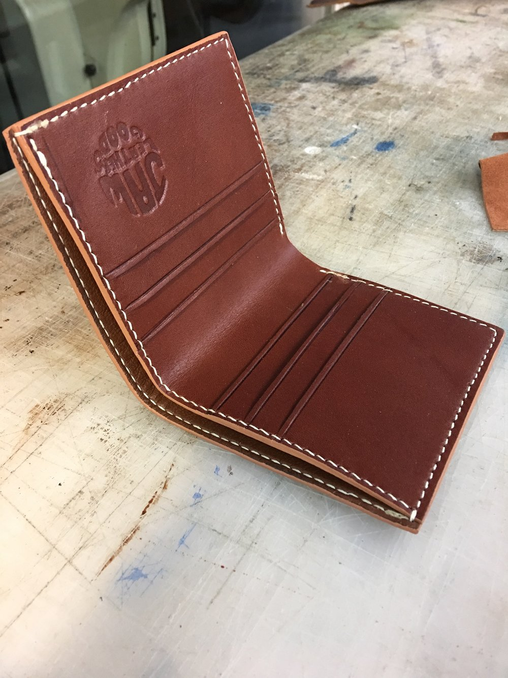 Modern wallet in brown bridle leather.  Hand cut, stitched and finished.