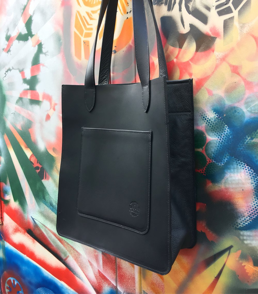 Thick black waxy cowhide is used in this one for the main panels and straps, while the gusset is made from soft black leather.  It gives the bag a more powerful look.