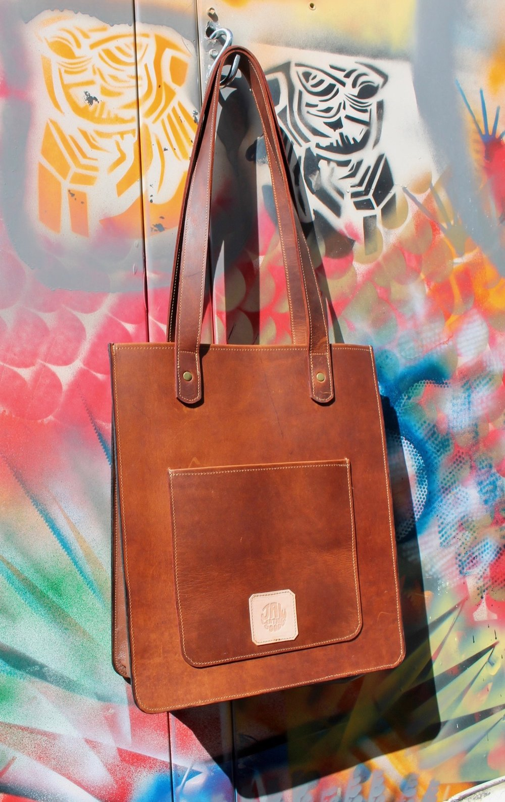 This bag is made of a nice pull up oil tan leather for the panels with a soft chap leather gusset.  I love this one, it is so classy.
