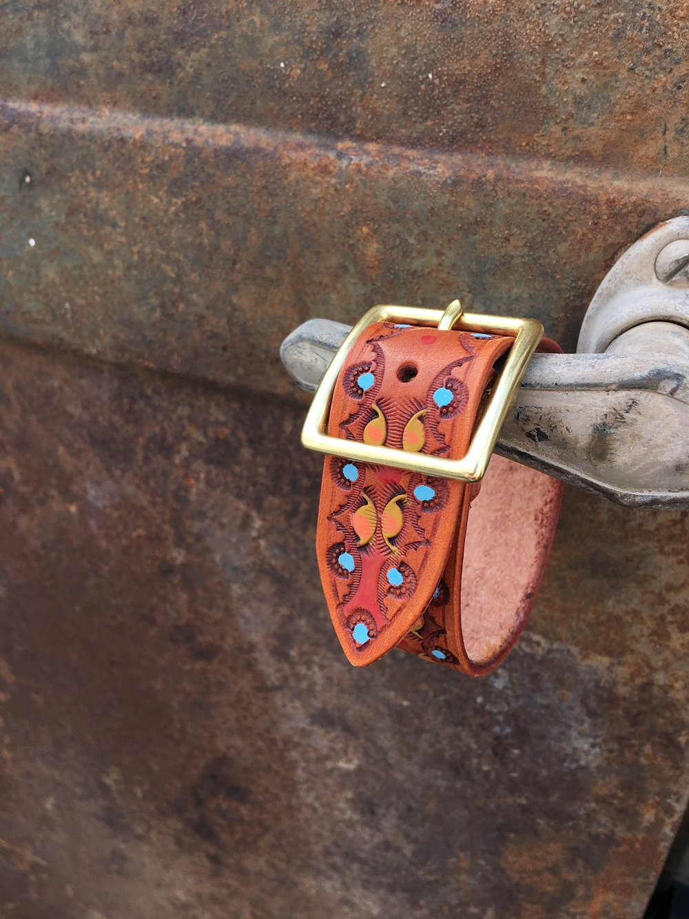"1"" wide tooled and painted leather bracelet"