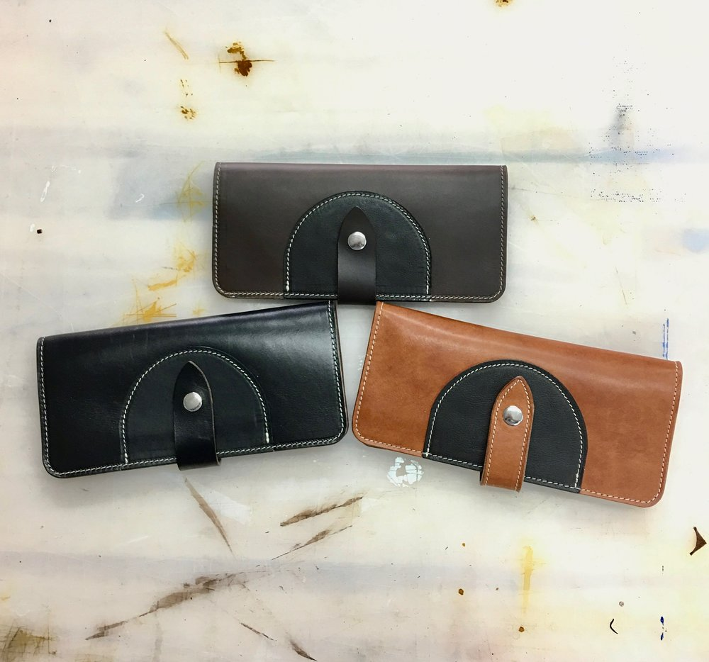 Trio of ladies wallets in different leathers.  Each features 8 card slots and two large bill slots.