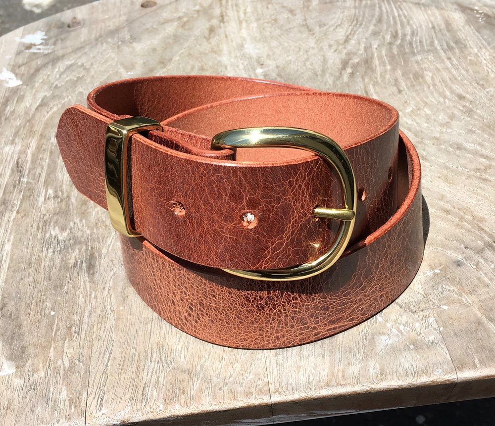 New belts should be in the shop later this week.  Made of a waxy vegetable tanned buffalo leather, these are awesome.  Features solid brass hardware.