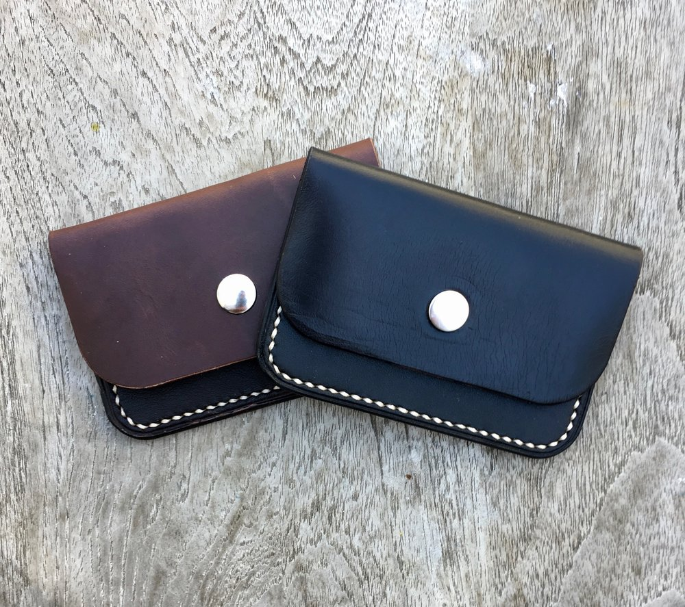 little snap wallets in brown or black Horween Chromexcel Horsehide.  The pocket is made from W and C English Bridle.  Holds about 6-8 cards and is just a slick way to roll.