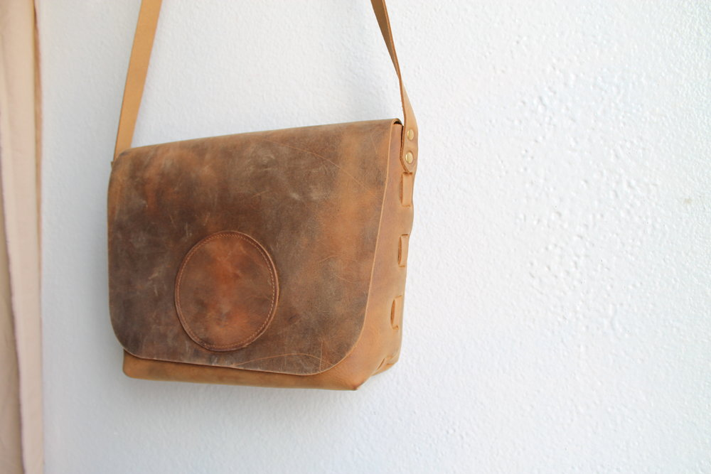 Our medium sized Superior Satchel is the perfect bag. Generously sized enough to hold a book, small notebook or sweater, yet still petite enough to be comfortable to carry around. Features our signature woven leather construction. This is our Dusty Brown Cowhide, a rustic waxy pull up leather that will break in and age beautifully over time. This leather will truly grow along with it's owner, creating a unique expression of how each bag was used.