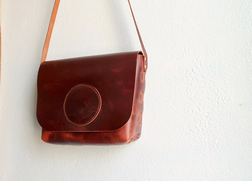Our Vintage Brown Cowhide has a smooth and sleek finish, but a rustic pull up as well. A deep red-brown, this leather will only get more beautiful with wear. All of our smaller satchels feature magnetic closure for convenient access to your stuff. Each bag has two interior pockets for small stuff, like your phone or keys.