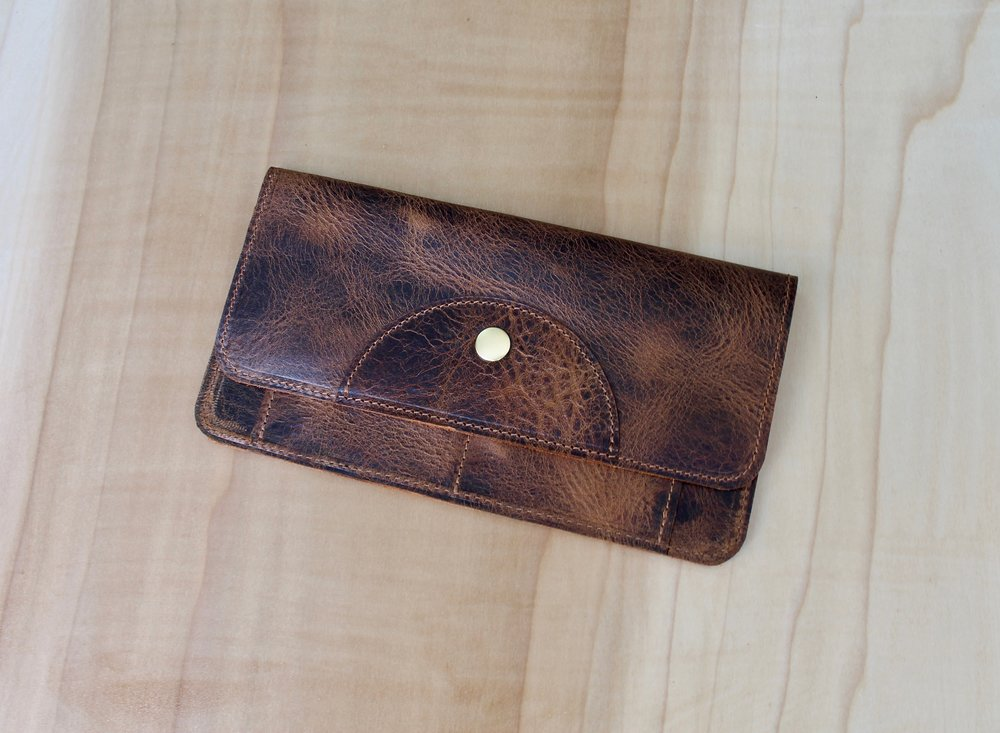 Our new Flat Wallet has everything you need. 2 exterior and 2 interior card slots, and a large open area for bills, your phone or whatever else you need. Can function easily as a bare bones clutch, or can easily be carried in your larger bag.