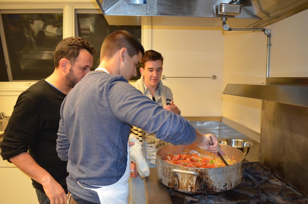 Cooking shakshuka in the Hillel kitchen