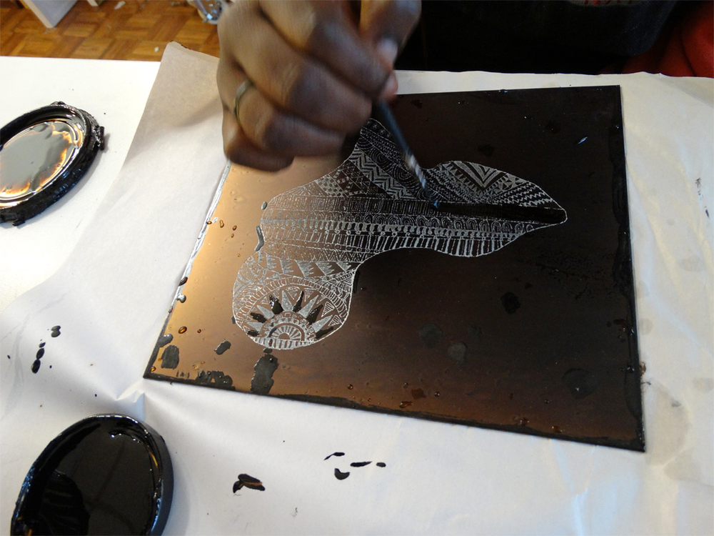 Ayel Akot adding detail to her etching