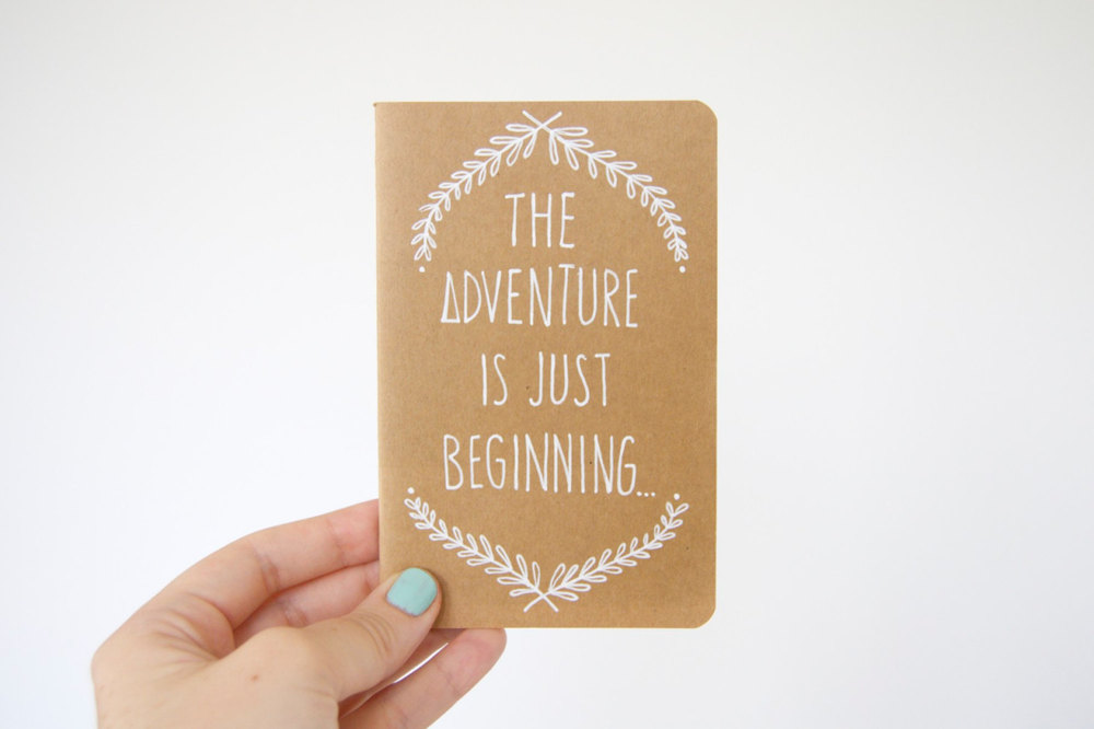 'The Adventure is just Beginning' hand illustrated moleskin journal, available here & here.