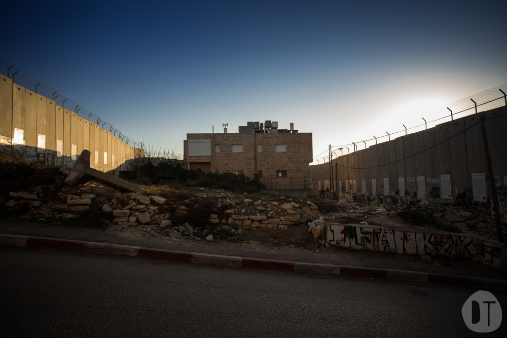 The separation barrier divided Hebron Road, the main route between Bethlehem and Jerusalem. It also completely surrounded this house.