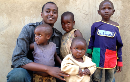 Pictured above: RC Founder, Serge Gasore, Jr., with some of our Rwandan children.