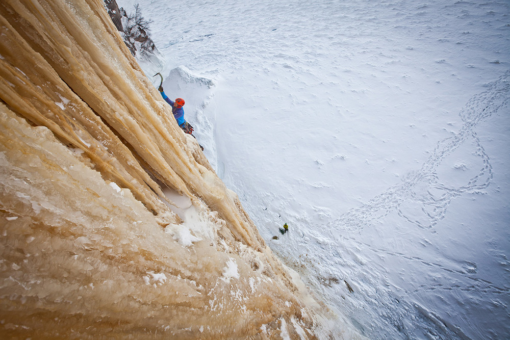 Adam Dailey works through dripping ice formations on his way up HMR.