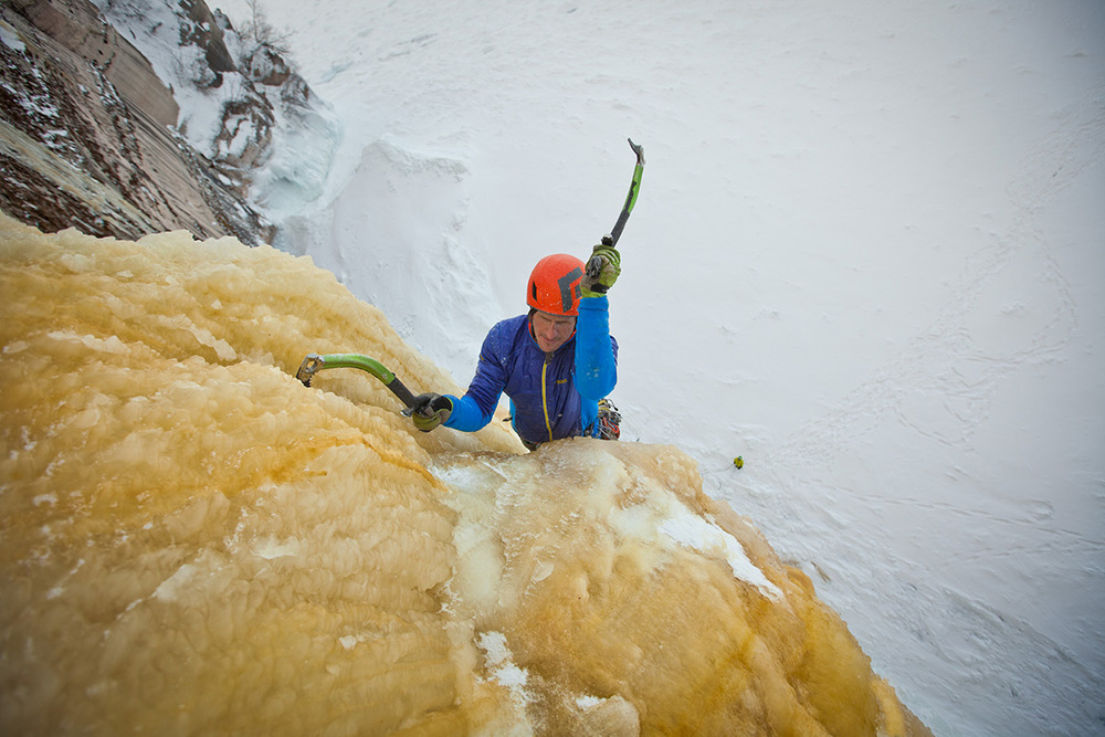 Adam Dailey making swing after swing to break through the bullet hard ice along the climb.