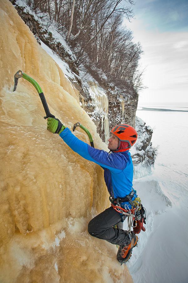Adam Dailey nears the top of HMR, a 60 meter ice climb along Lake Superior.