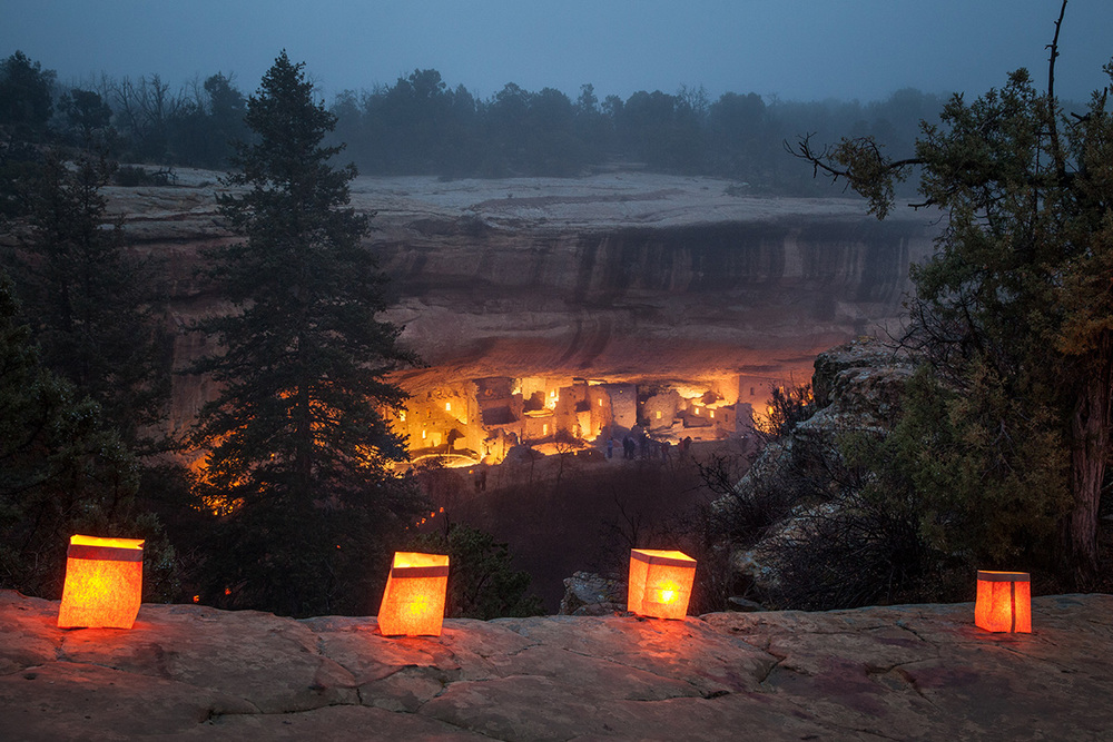 Spruce Tree House lit up during the annual Luminarias event at Mesa Verde National Park.