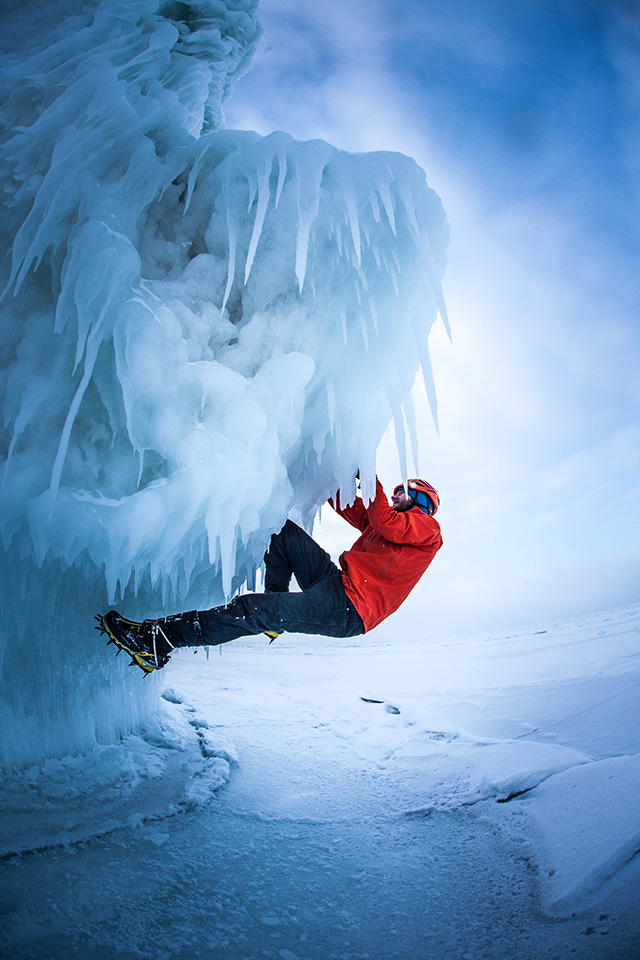 Local Ice Climbing Guide Nic Dobbs getting on some ice boulders on Mosquito Beach.