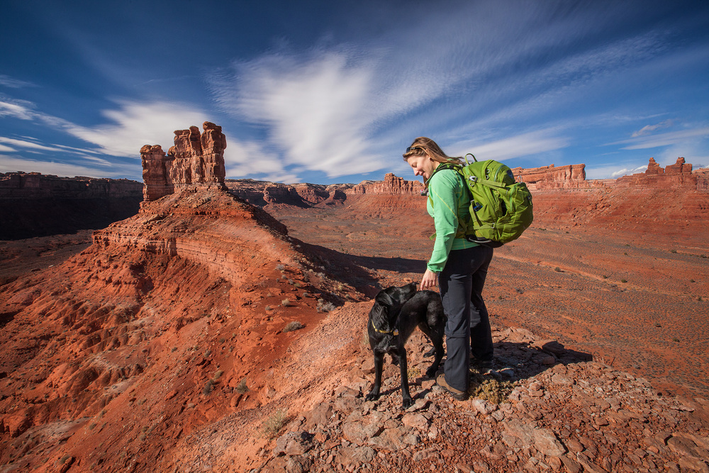 Hiking along rocky cliffs in the desert climate of Valley of the Gods, Utah.