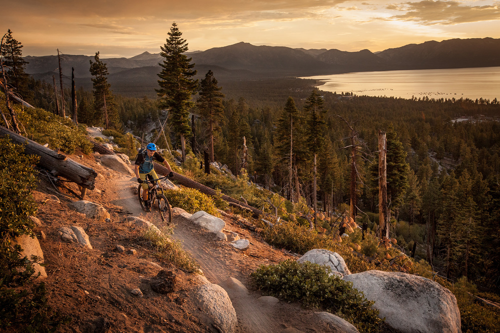 Sunset along Lake Tahoe while James Sunkel races along the Van Sickle Trail on his mountain bike.