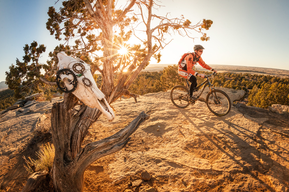 Osprey athlete Jeff Fox sneaks in a few sunset laps at Phil's World mountain bike trail in Cortez, Colorado.