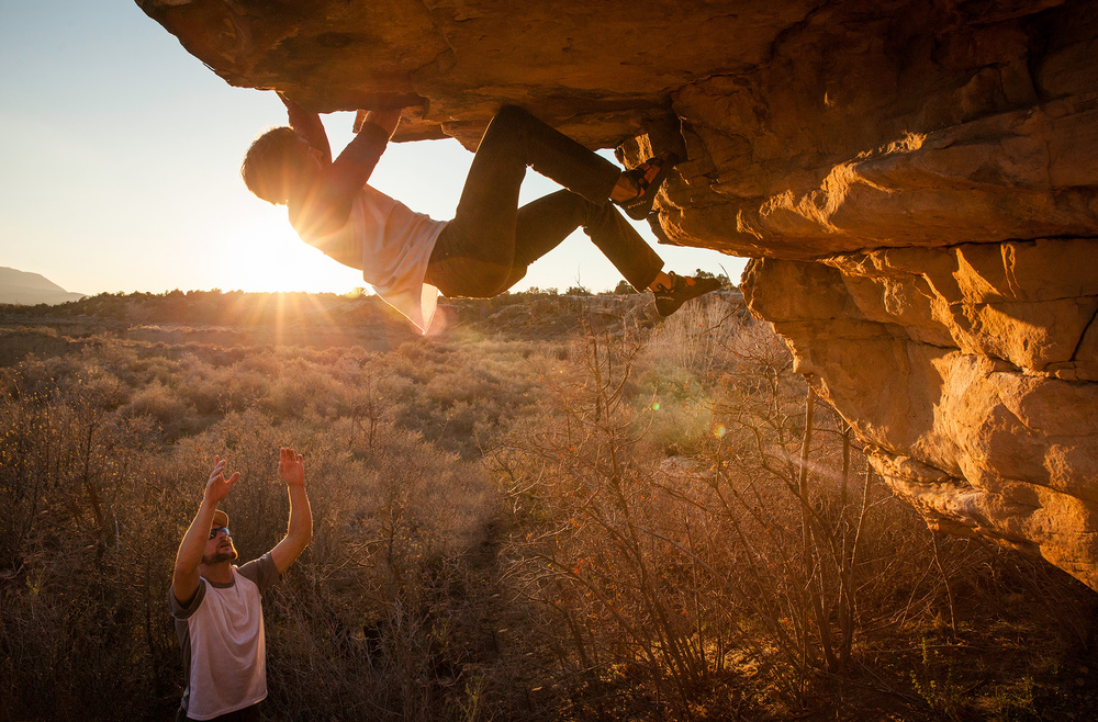 Mychal McCormick cranks through the roof on a steep boulder problem in Cortez, Colorado.