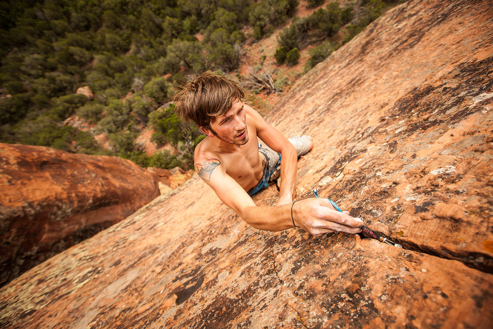 Tim Shelton places small gear on a steep crack trad climb in Southwest Colorado.